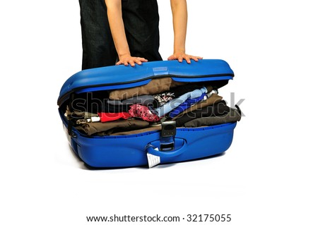 close the suitcase - stock photo