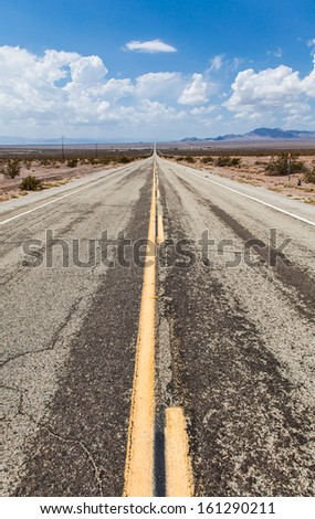 Close to Amboy (USA). Old part of Route 66 in the middle of the desert - stock photo