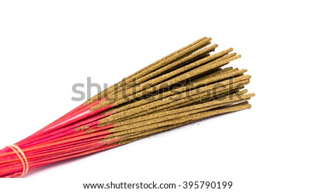 Close-up a bunch of incense sticks isolated on white. Incense use in religious ritual.Its burned to intend as a sacrificial offering to various deity or to serve as an aid in prayer. Panoramic style. - stock photo