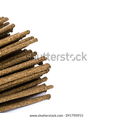 Close-up a bunch of incense sticks isolated on white. Incense use in religious ritual.Its burned to intend as a sacrificial offering to various deity or to serve as an aid in prayer. Copy space. - stock photo