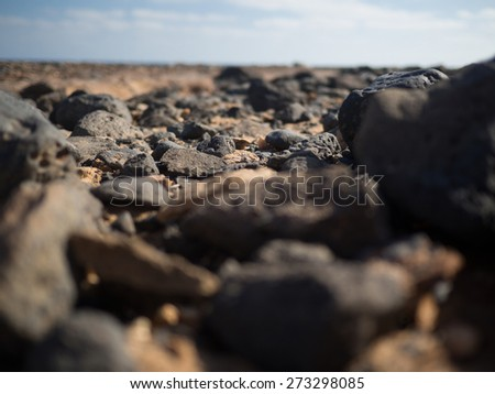 Close up a couple of stones on the beach (selective focus) - stock photo
