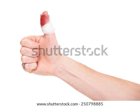 Close-up a finger with bloody gauze on it. - stock photo
