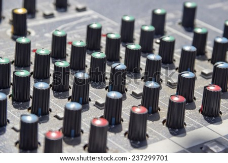 close-up a knob on a mixing board of a preamp - stock photo