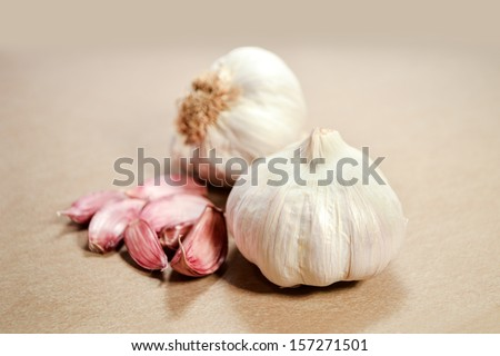 close up  a two garlic and wood background - stock photo