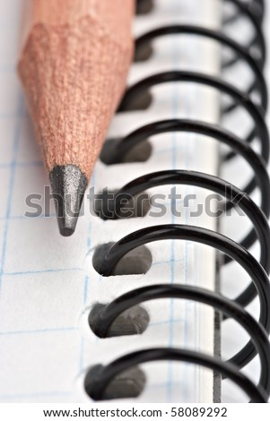 Close up a wooden pencil on the book - stock photo