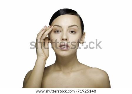 Close up a young beautiful brunette girl with hand near her eye isolated - stock photo