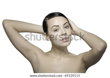 Close up a young beautiful brunette girl with hands holding her hair isolated - stock photo