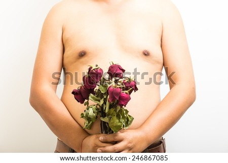 "Close up abdomen and withered rose on white background. concept "" Fat body side can make  rejects love """