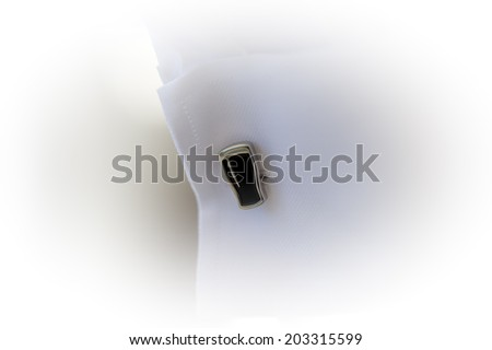 Close-up about groom cufflinks - stock photo