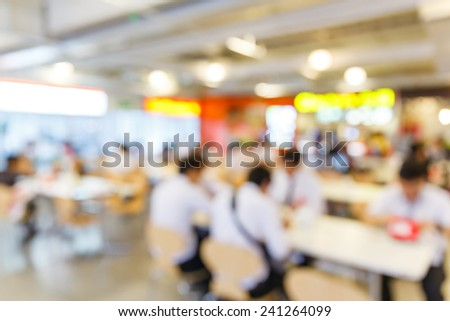 Close up abstract blurred people in food center - stock photo