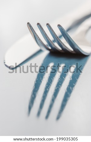 Close up abstract of a silver knife and fork