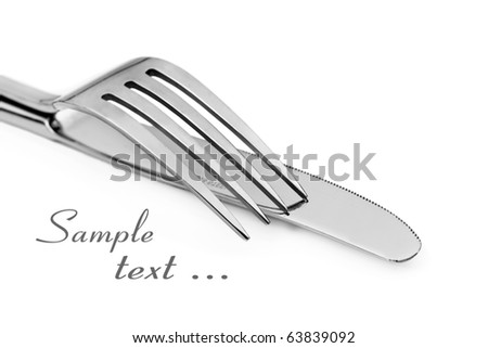 Close up abstract of a silver knife and fork on a white background with space for text - stock photo