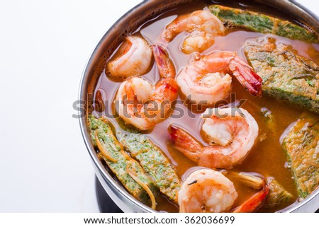 Close up  accacia leave omelet and shrimp in tamarind flavor sour soup (Sweet and sour soup) - stock photo