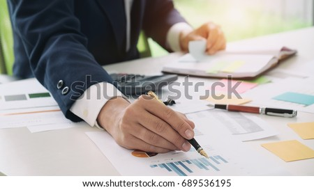 Close up accountant or banker making calculations. Savings, finances and economy concept.
