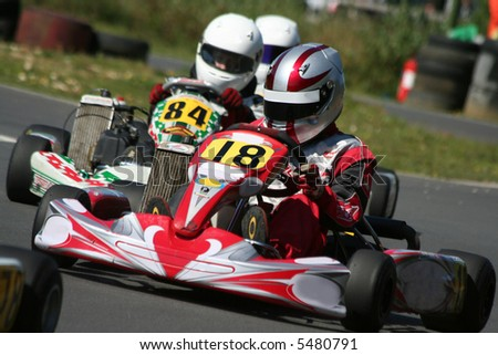 Close up action of a go kart race - stock photo