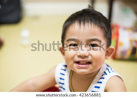 Close up,Adorable little boy smiling - stock photo