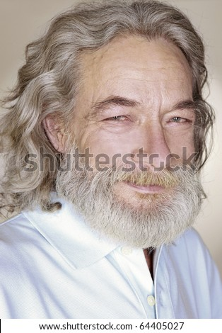 close-up adult old man with gray hair smiles
