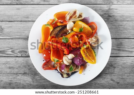 Close up Aerial Shot of Appetizing Healthy Recipe with Mushrooms and Spices on White Plate. Placed on Wooden Table. - stock photo