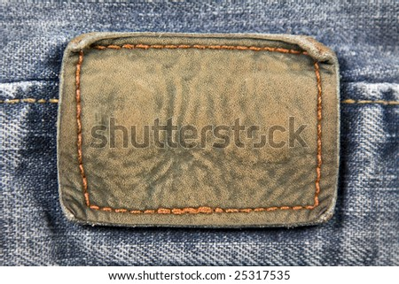Close up aged blank leather patch on the back of a pair of jeans. - stock photo