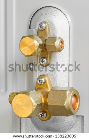 Close up air conditioner service and shut off valve on new condenser unit - deep focus photo - stock photo