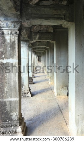 close-up aisle with columns in the ancient temple of Angkor Wat, Cambodia