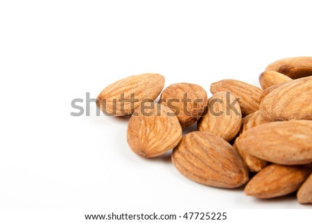 Close-up almonds isolated on a white background.