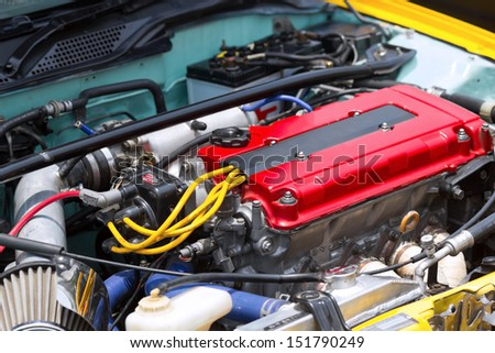 Close up an engine in a car - stock photo