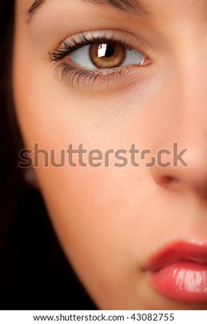 Close-up and half of an attractive woman's face. - stock photo