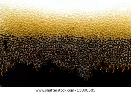 close-up appetizing dark beer with bubbles
