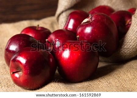 Close-up Apples spilling from basket - stock photo