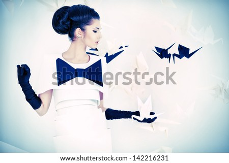 Close-up art fashion photo of a gorgeous woman in paper dress. Black and white. - stock photo