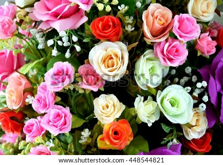 Close up Artificial flowers pots in garden, artificial orange, white, and pink roses bouquet close up from top view, roses flowers for wedding decoration - stock photo