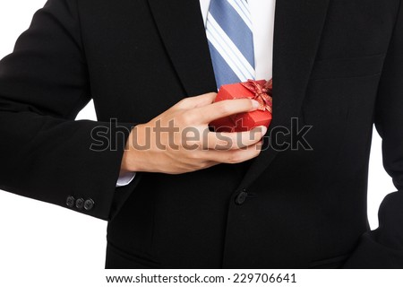 Close up Asian businessman pull a gift box from his suit