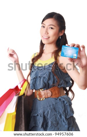 Close-up Asian woman holding credit card and shopping bags - stock photo