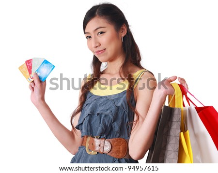 Close-up Asian woman holding credit card and shopping bags