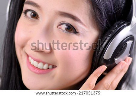 Close up Asian woman teenager listing for relaxation with Headphone and happy emotion
