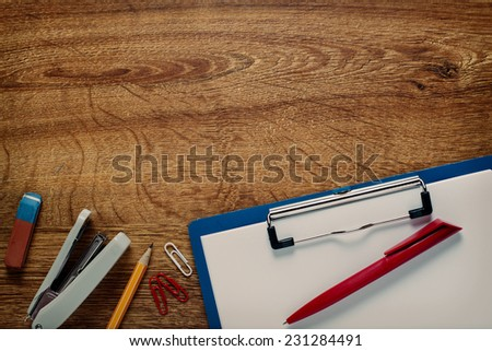Close up Assorted Office Supplies and Clipboard on Top of the Desk with Copy Space for Texts. - stock photo