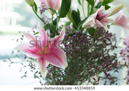 Close up at Bouquet of fresh pink lilies flower for valentine day, Select focus at lily flower - stock photo