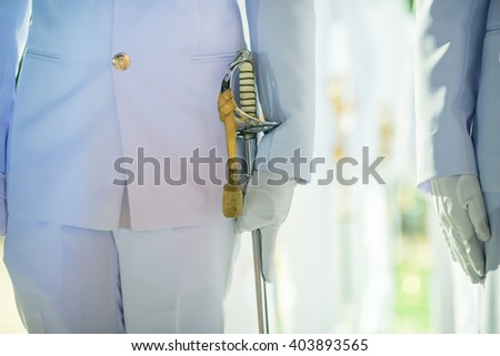 Close up at Hand with saber of military personnel in dress uniform prepare to Saber Arch position in their wedding traditional in Thailand