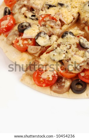 Close up at italian pizza with tomatoes and olive.