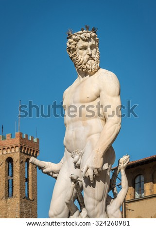 Close-up at Statue of Neptune with tower in background, Piazza della Signoria, Florence (Italy) - stock photo