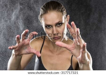 Woman reaching up to camera