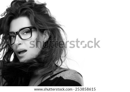 Close up attractive model woman face with casual hairstyle, wearing fashion eyeglasses while looking at camera. Cool trendy eyewear portrait. Monochrome isolated on white with Copy Space for Text - stock photo