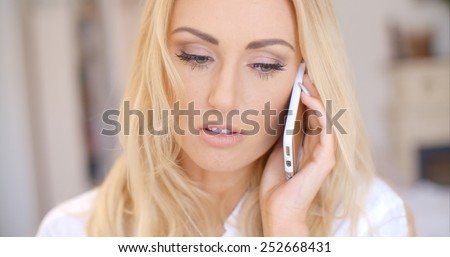 Close up Attractive Young Blond Woman Calling Someone Through her Mobile Phone - stock photo