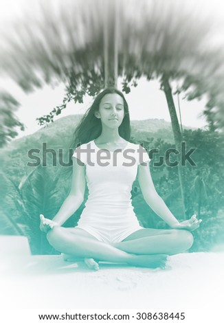 Close up Attractive Young Woman Performing Lotus Yoga Position on White Beach Sand with Closed Eyes - stock photo