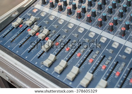 close up audio mixing console and faders