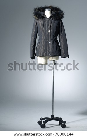 Close up autumn/ winter clothes on mannequin isolated light background