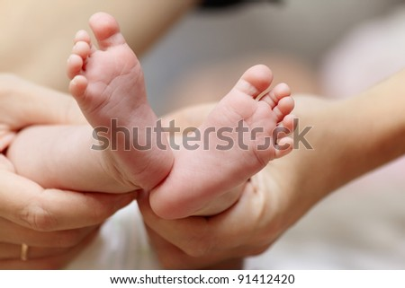 Close up baby foot in parent hand