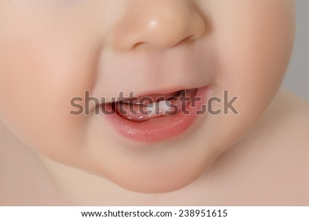 close-up Baby mouth with two rises teeth - stock photo