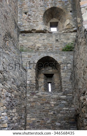 close-up background loop-hole in the stone wall of the castle in natural light